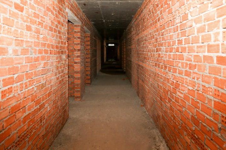 Đã xây tường bao căn hộ tầng 13 – block A